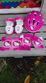 Hello kitty roller skates with helmet, elbow and knee pads