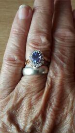 14 Diamond and Tanzinite 18ct yellow gold ring