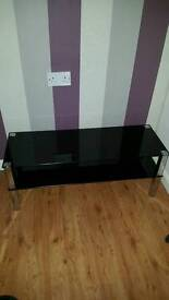 Black glass and metal (square) TV stand and 2x matching end tables.