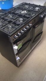 Brand New dual fuel Range Cooker, Gas hobs, 2 electric ovens plus storage