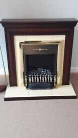 electric fire, mahogany surround and brass inset