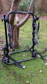 Strap-on bike rack for three bikes