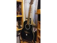 Acoustic / electric guitar, plus two amps and accessories