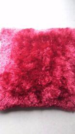 4 Red shaggy cushions