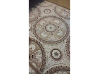 Large cream and brown rug