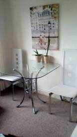 Modern glass table and two chairs