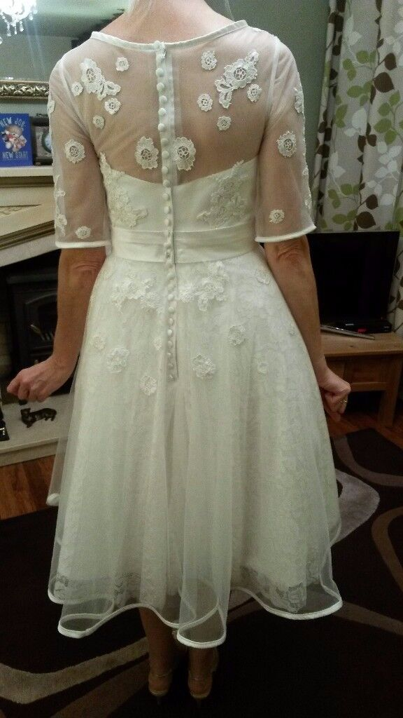 Ivory Tea length wedding dress size 12. Never worn.
