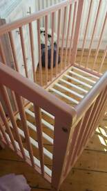 lovely soft pale pink space saving cot.