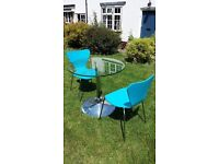 Round glass top dining table including two chairs