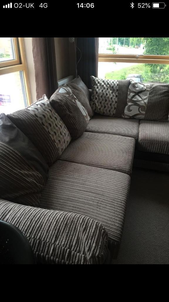Brown L shape corner sofa