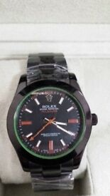 rolex milgauss all black orange sweeping hand sapphire glass waterproof 50m heavy in weight