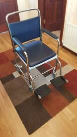 Mobile wheeled commode chair/wheelchair with padded seat and brakes
