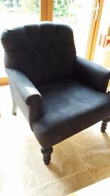 Blue button backed armchair