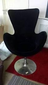 Black velvet swivel chair