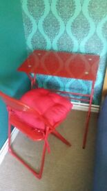 Red glass table and chair with cushion