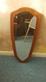 Retro Mirror on wooden background