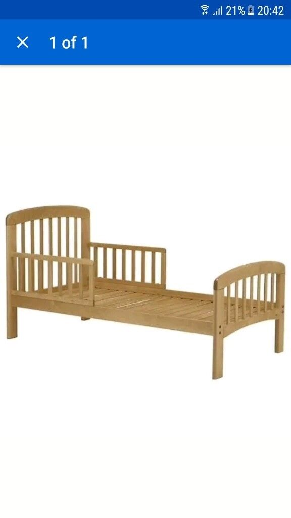 John lewis toddlers cot bed comes with mattress (coconut) and mattress waterproof protector.