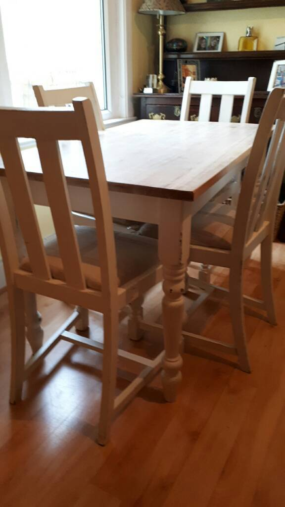 Pretty table 4ft by 2ft 4 inches with painted base and 4 chairs