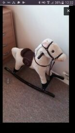 REDUCED 10 POUND GONE TODAY !!immaculate rocking horse - used 2 times - smoke and pet free home