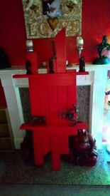 Wooden hand made shelf in rich red