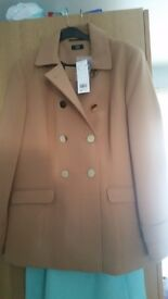 Bnwt size 16. I got the wrong size. The jacket has spare buttons attached to the tag.