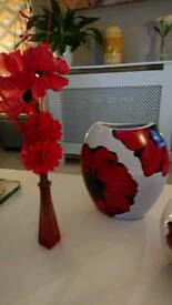 Red vase and flowers