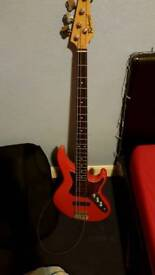 Red RichWood Bass Guitar with Amplifier