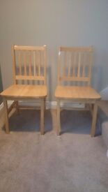 Two lovely wooden dining / kitchen chairs.