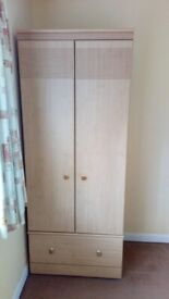 Freestanding light colour wardrobe with single drawer on wheels