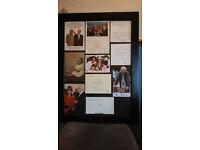 Celebrity signed cards. Mounted in large frame.