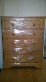 FREE chest of drawers, laminate, on casters (wrapped in plastic in photo)