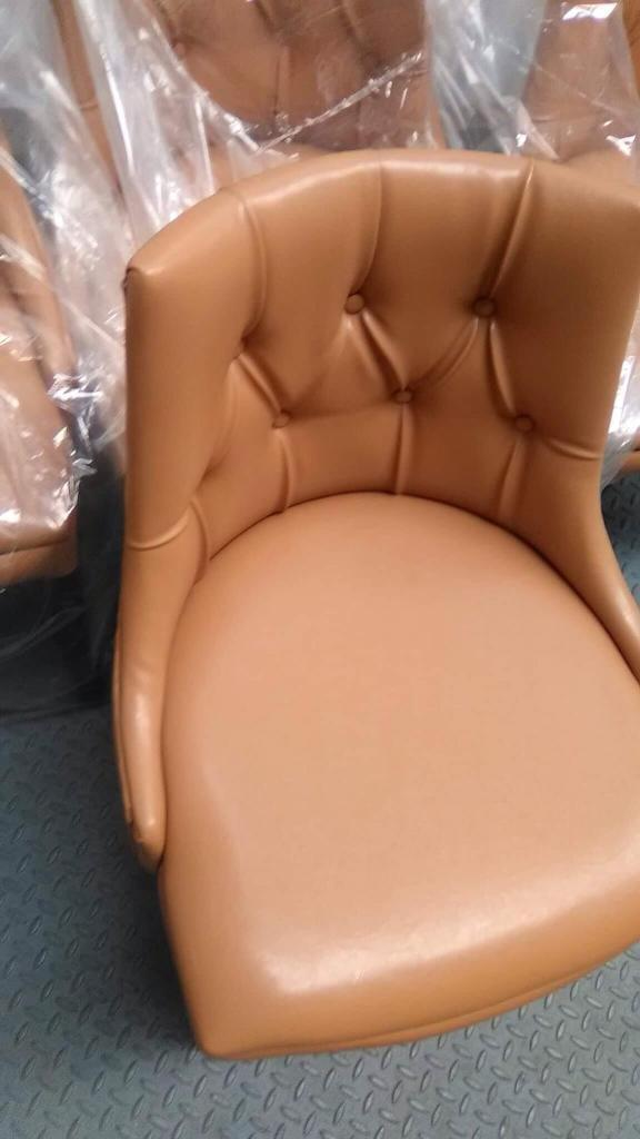 Set of 4 tanned chairs