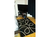 Urgent due to move 2 Carpets , french branded, Black background with white lines