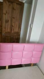 Single pink leather effect head board.