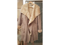Beautiful ladies fur lined coat, brand new with tags