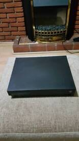 Xbox one X with two games