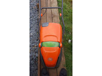 Flymo lawnmower electric. Like new collects the grass in box quick and easy to empty