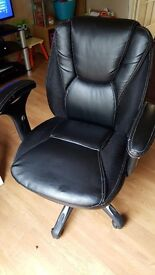 Used black leather office computer chair on wheels