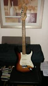 Stratocaster Style Electric Guitar by Stagg, includes 10w amp and lead
