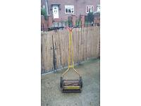 old push along garden grass cutter