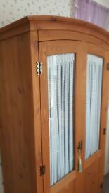 attractive wooden wardrobe with double glass fronted doors. Single hanging rail and