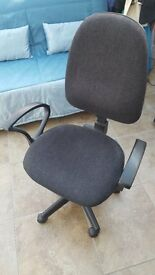 Grey wheeley office chair