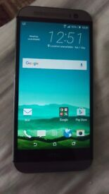 Htc one m8 looks nearly new original screen and back looks nearly new