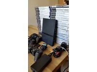 PS 2 for sale with 50 games