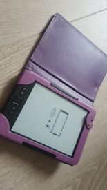 Kindle 4th generation and purple case and charger