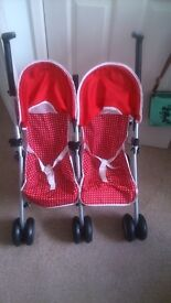 Little twin toy pushchair