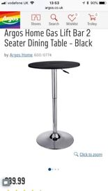 Gas lift black bar table. 2 seater.