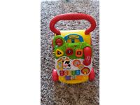 vtech push walker and play table.