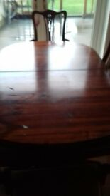 extenable dinning table and 6 chairs