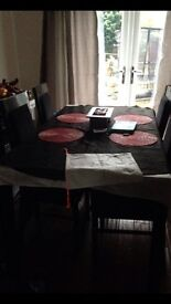 Black gloss dining table housing units